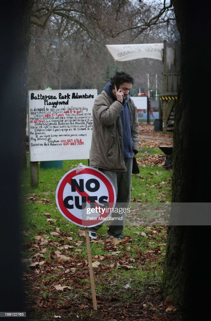 An activist, who is inside the now locked Battersea Park adventure playground, speaks on the telephone on January 8, 2013 in London, England. Activists and local residents oppose local authority plans to demolish the adventure playground, which has been mostly used by teenagers, and replace it with facilities for younger children who will need less supervision.
