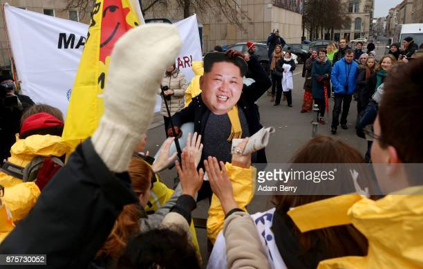 An activist with a mask of Kim Jongun chairman of the Workers' Party of Korea and supreme leader of North Korea marches during a demonstration...