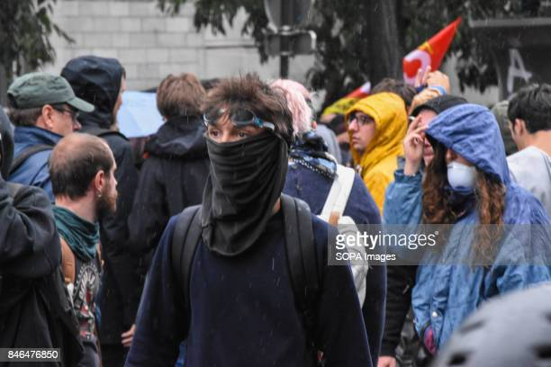 An activist with a scarf covering his face is seen during the nationwide strike called by various French unions against proposed labour law reforms...