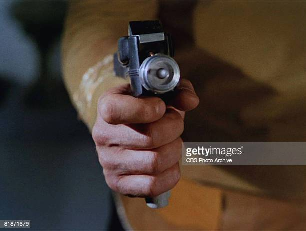An actor aims a phaser in a scene from 'The Man Trap' the premiere episode of 'Star Trek' which aired on September 8 1966