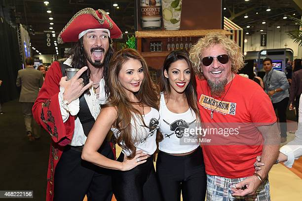 An actor as brand icon 'Captain Morgan' promotional models the Morganettes and recording artist Sammy Hagar attend the 30th annual Nightclub Bar...