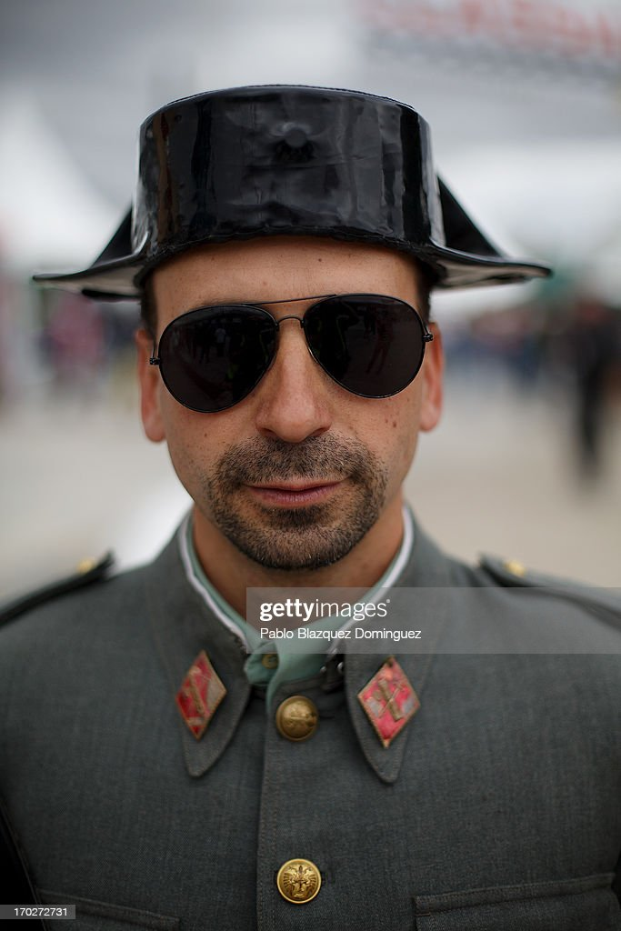 An actor dressed as a Civil Guard poses for a picture at the Jarama Circuit on June 9, 2013 in Madrid, Spain. The Jarama Vintage Festival seeks to revive the 1960s, 70s and 80s attracting classic cars and motorbikes against a background of public orientated activities and shows.