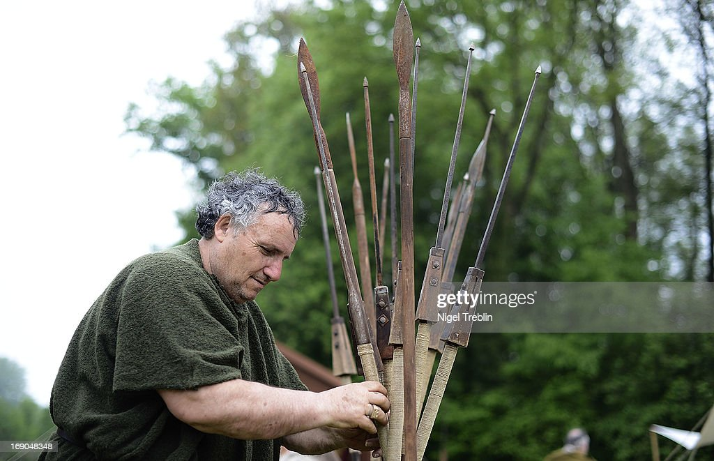 An actor dressed as a Roman soldier arranges lances during a commemoration of the Battle of Teutoburg Forest (in German called the Varusschlacht) at the Kalkriese Museum and Park on May 19, 2013 in Bramsche-Kalkriese, Germany. Several hundred actors dressed as Roman and Germanic soldiers took part in the public event that included a cavalry display, hand to hand combat between gladiators and demonstrations of Roman artillery. The Battle of Teutobug Forest in 9 A.D. was a monumental defeat for the Romans in Germania, in which three legions led by Publius Quinctilius Varus were betrayed by Arminius, who was secretly aligned with Germanic tribes and led the legions into a trap in which up to 20,000 Roman soldiers were killed at the hands of Germanic warriors.