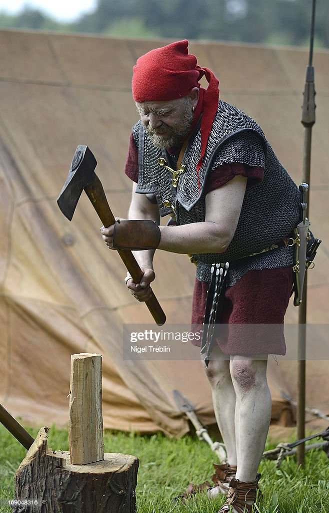 An actor dressed as a Roman soldier prepares wood for a bonfire during a commemoration of the Battle of Teutoburg Forest (in German called the Varusschlacht) at the Kalkriese Museum and Park on May 19, 2013 in Bramsche-Kalkriese, Germany. Several hundred actors dressed as Roman and Germanic soldiers took part in the public event that included a cavalry display, hand to hand combat between gladiators and demonstrations of Roman artillery. The Battle of Teutobug Forest in 9 A.D. was a monumental defeat for the Romans in Germania, in which three legions led by Publius Quinctilius Varus were betrayed by Arminius, who was secretly aligned with Germanic tribes and led the legions into a trap in which up to 20,000 Roman soldiers were killed at the hands of Germanic warriors.