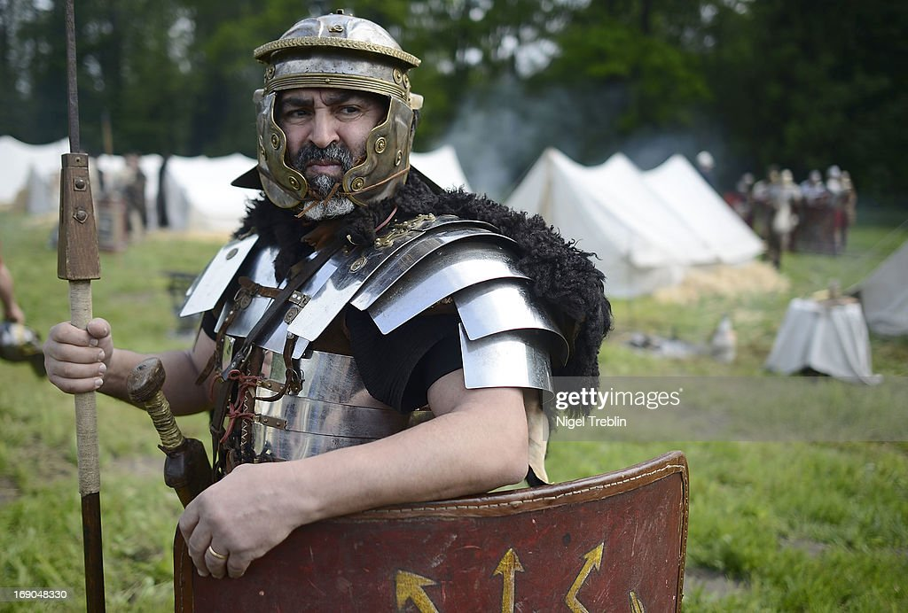 An actor dressed as a Roman soldier stand guard in front of a camp a during a commemoration of the Battle of Teutoburg Forest (in German called the Varusschlacht) at the Kalkriese Museum and Park on May 19, 2013 in Bramsche-Kalkriese, Germany. Several hundred actors dressed as Roman and Germanic soldiers took part in the public event that included a cavalry display, hand to hand combat between gladiators and demonstrations of Roman artillery. The Battle of Teutobug Forest in 9 A.D. was a monumental defeat for the Romans in Germania, in which three legions led by Publius Quinctilius Varus were betrayed by Arminius, who was secretly aligned with Germanic tribes and led the legions into a trap in which up to 20,000 Roman soldiers were killed at the hands of Germanic warriors.