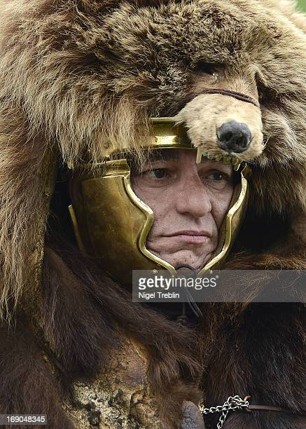An actor dressed as a Roman soldier wears a busby during a commemoration of the Battle of Teutoburg Forest at the Kalkriese Museum and Park on May 19...