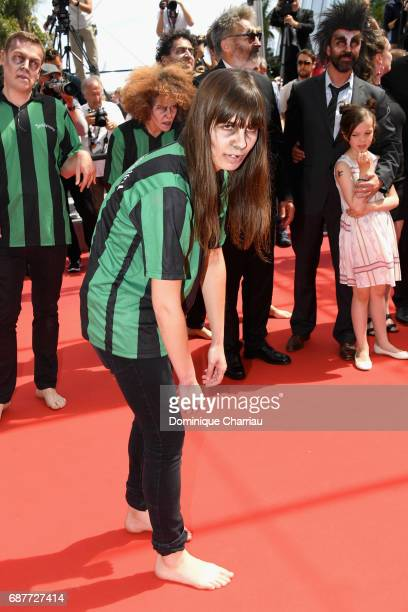 An actor dressed as a zombie arrives with the cast of 'Zombillenium' attends the 'Rodin' screening during the 70th annual Cannes Film Festival at...