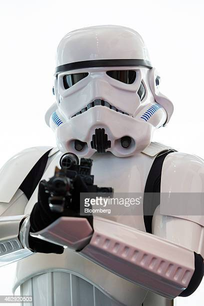 An actor dressed as an Imperial stormtrooper a Star Wars character poses for a photograph during the opening ceremony for Lucasfilm Ltd's Sandcrawler...