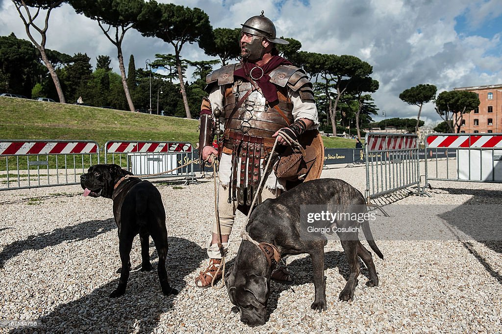 An actor dressed as ancient Roman soldier hold two dogs as he gets ready to march in a commemorative parade during festivities marking the 2,766th anniversary of the founding of Rome on April 21, 2013 in Rome, Italy. The capital celebrates its founding annually based on the legendary foundation of the Birth of Rome. Actors dressed as the denizens of ancient Rome participate in parades and re-enactments of the ancient Roman 753 BC in an area surrounded by seven hills.