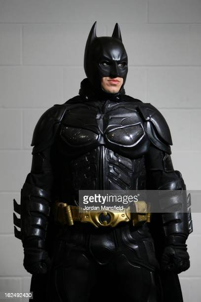 An actor dressed as Batman poses for a photo at the London Super Comic Convention at the ExCeL Centre on February 23 2013 in London England...