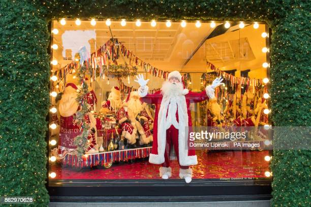 An actor dressed as Father Christmas inside a Christmas window display themed as With Love From which is a celebration of the cities Selfridges calls...