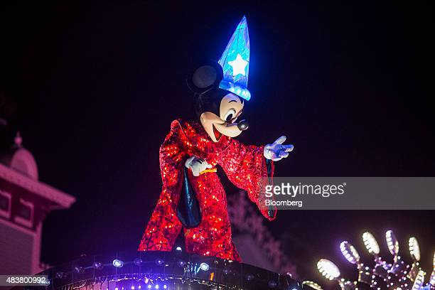 An actor dressed as Mickey Mouse performs during the 'Disney Paint the Night' Nighttime Spectacular parade at night at Walt Disney Co's Disneyland...
