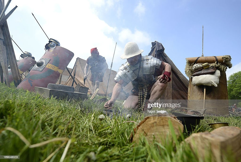 An actor dressed as Roman prepares a bonfire during a commemoration of the Battle of Teutoburg Forest (in German called the Varusschlacht) at the Kalkriese Museum and Park on May 19, 2013 in Bramsche-Kalkriese, Germany. Several hundred actors dressed as Roman and Germanic soldiers took part in the public event that included a cavalry display, hand to hand combat between gladiators and demonstrations of Roman artillery. The Battle of Teutobug Forest in 9 A.D. was a monumental defeat for the Romans in Germania, in which three legions led by Publius Quinctilius Varus were betrayed by Arminius, who was secretly aligned with Germanic tribes and led the legions into a trap in which up to 20,000 Roman soldiers were killed at the hands of Germanic warriors.