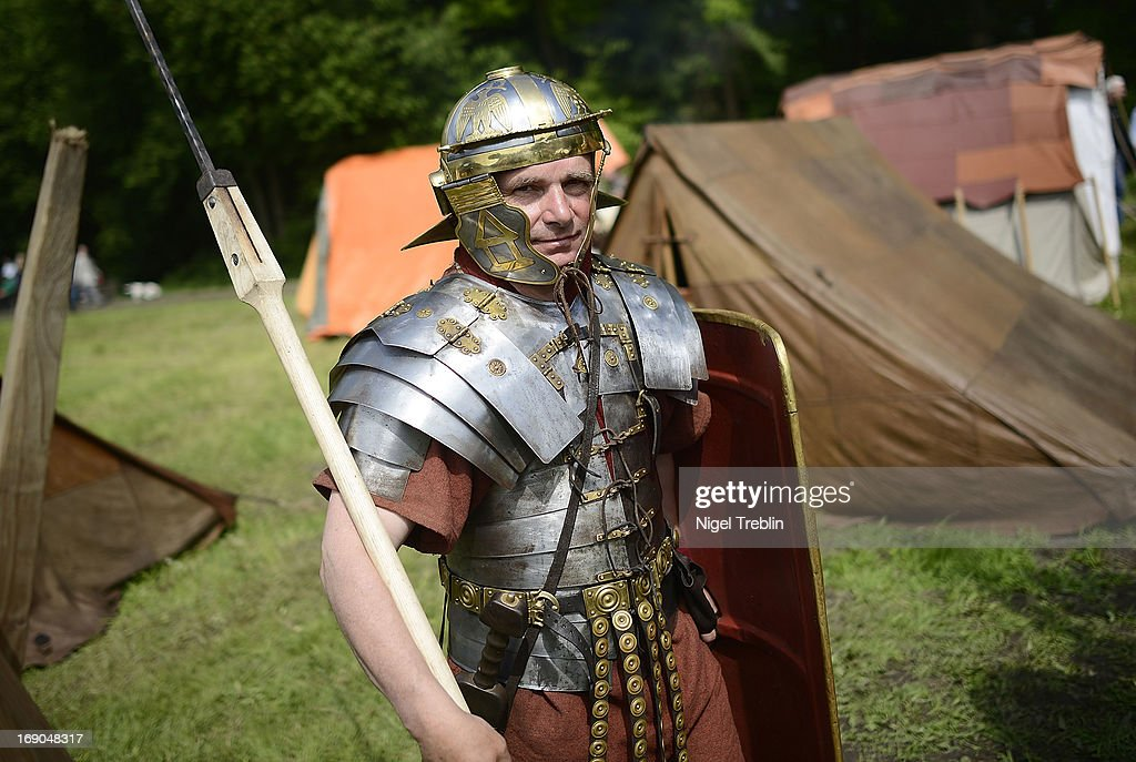 An actor dressed as Roman soldier is seen during a commemoration of the Battle of Teutoburg Forest (in German called the Varusschlacht) at the Kalkriese Museum and Park on May 19, 2013 in Bramsche-Kalkriese, Germany. Several hundred actors dressed as Roman and Germanic soldiers took part in the public event that included a cavalry display, hand to hand combat between gladiators and demonstrations of Roman artillery. The Battle of Teutobug Forest in 9 A.D. was a monumental defeat for the Romans in Germania, in which three legions led by Publius Quinctilius Varus were betrayed by Arminius, who was secretly aligned with Germanic tribes and led the legions into a trap in which up to 20,000 Roman soldiers were killed at the hands of Germanic warriors.