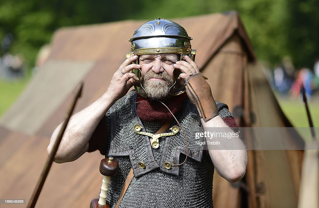 An actor dressed as Roman soldier prepares his helmet during a commemoration of the Battle of Teutoburg Forest (in German called the Varusschlacht) at the Kalkriese Museum and Park on May 19, 2013 in Bramsche-Kalkriese, Germany. Several hundred actors dressed as Roman and Germanic soldiers took part in the public event that included a cavalry display, hand to hand combat between gladiators and demonstrations of Roman artillery. The Battle of Teutobug Forest in 9 A.D. was a monumental defeat for the Romans in Germania, in which three legions led by Publius Quinctilius Varus were betrayed by Arminius, who was secretly aligned with Germanic tribes and led the legions into a trap in which up to 20,000 Roman soldiers were killed at the hands of Germanic warriors.
