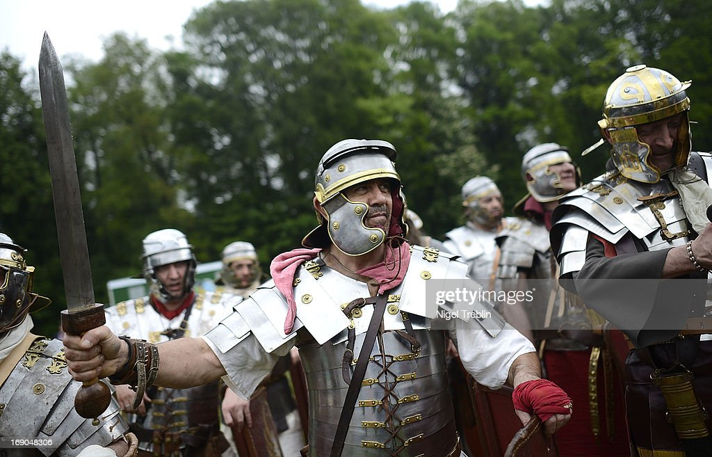 An actor dressed as Roman soldier shows his sword during a commemoration of the Battle of Teutoburg Forest (in German called the Varusschlacht) at the Kalkriese Museum and Park on May 19, 2013 in Bramsche-Kalkriese, Germany. Several hundred actors dressed as Roman and Germanic soldiers took part in the public event that included a cavalry display, hand to hand combat between gladiators and demonstrations of Roman artillery. The Battle of Teutobug Forest in 9 A.D. was a monumental defeat for the Romans in Germania, in which three legions led by Publius Quinctilius Varus were betrayed by Arminius, who was secretly aligned with Germanic tribes and led the legions into a trap in which up to 20,000 Roman soldiers were killed at the hands of Germanic warriors.