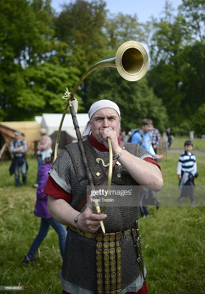 An actor dressed as Roman whistles during a commemoration of the Battle of Teutoburg Forest (in German called the Varusschlacht) at the Kalkriese Museum and Park on May 19, 2013 in Bramsche-Kalkriese, Germany. Several hundred actors dressed as Roman and Germanic soldiers took part in the public event that included a cavalry display, hand to hand combat between gladiators and demonstrations of Roman artillery. The Battle of Teutobug Forest in 9 A.D. was a monumental defeat for the Romans in Germania, in which three legions led by Publius Quinctilius Varus were betrayed by Arminius, who was secretly aligned with Germanic tribes and led the legions into a trap in which up to 20,000 Roman soldiers were killed at the hands of Germanic warriors.