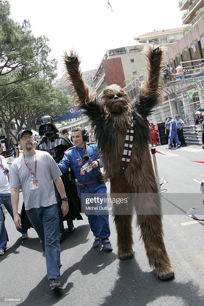 An actor dressed as Star Wars character Chubaka walks in the pit lane before the Monaco Grand Prix on May 22, 2005 in Cannes, France.