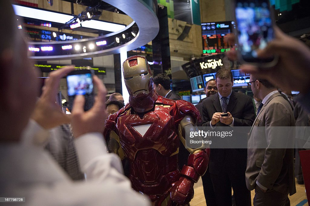 An actor dressed as the character Iron Man poses for pictures at the New York Stock Exchange (NYSE) in New York, U.S., on Tuesday, April 30, 2013. U.S. stocks fell as business activity unexpectedly shrank in April for the first time in more than three years, offsetting a rise in confidence among American consumers. Photographer: Scott Eells/Bloomberg via Getty Images
