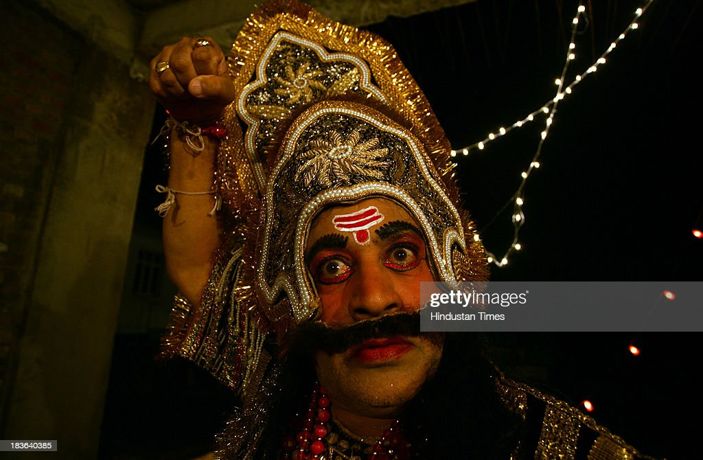 An actor dressed as the Hindu demon king Ravan as he prepares backstage for a performance of the Ramlila on October 7, 2013 in Jammu, India. Ramlila is a dramatic folk re-enactment of the life of Hindu Lord Rama's victory after a ten day battle with the ten headed Demon King Ravana.
