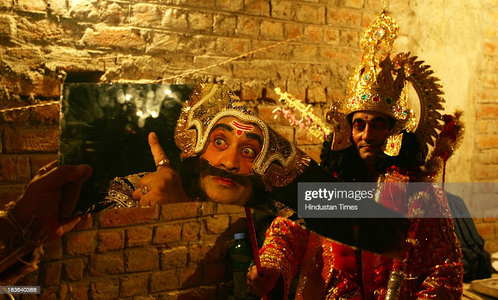 An actor dressed as the Hindu demon king Ravan as he prepares backstage for a performance of the Ramlila on October 7 2013 in Jammu India Ramlila is...