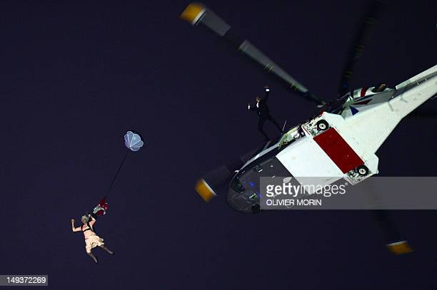 An actor dressed to resemble Britain's Queen Elizabeth II parachutes into the stadium during the opening ceremony of the London 2012 Olympic Games at...