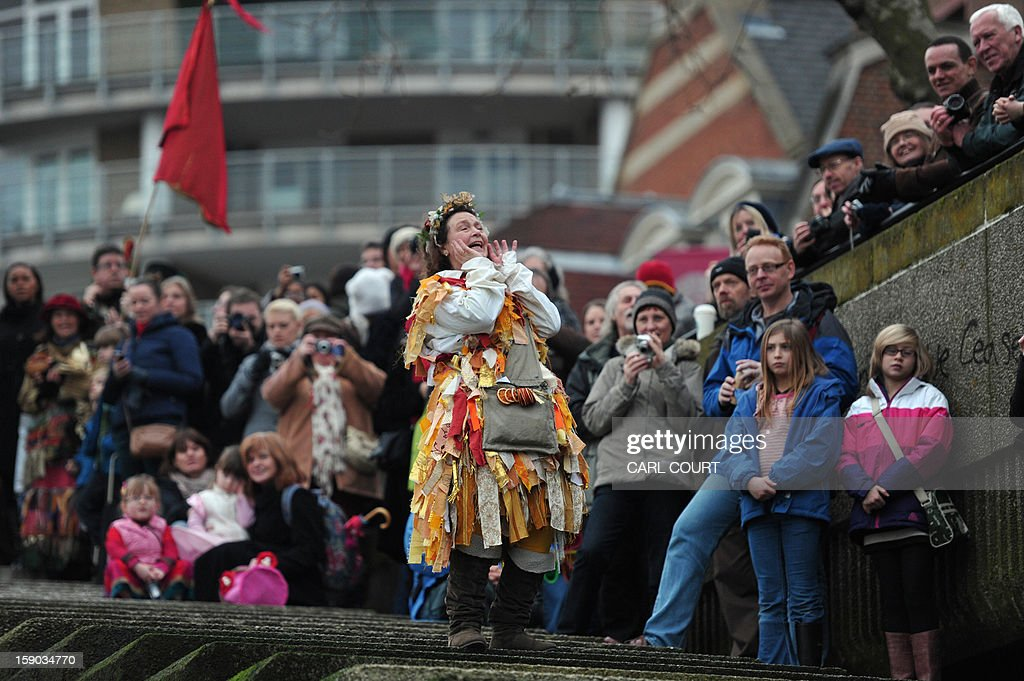 An actor from The Bankside Mummers group (from the Lions part) announces the arrival of the The Holly Man, the winter guise of the Green Man, a character from pagan myths and folklore, in a folk play near the Globe Theatre in central London on January 6, 2013, in celebration of Twelfth Night, marking the end of the twelve days of winter festivities. Twelfth Night celebrations in the traditional agricultural calendar mark a last chance to make merry before returning to the rigours of work on Plough Monday.