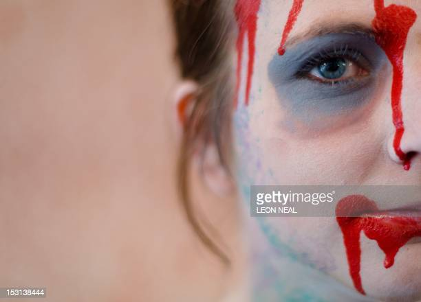 An actor has the final touches of her makeup applied ahead of the last of three nights of the zombie chase game '28 Hours Later' in central...