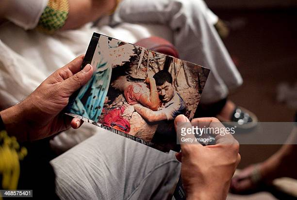 An actor holds a photo from the Rana Plaza disaster while filming a movie titled Rana Plaza February 7 2014 in Dhaka Bangladesh The movie tells the...