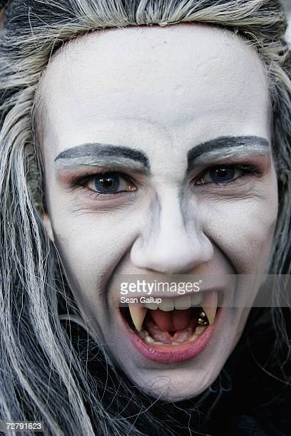 An actor made up as a vampire shows off his teeth at the Berlin premiere of 'Dance of the Vampires' at the Theater des Westens December 10 2006 in...