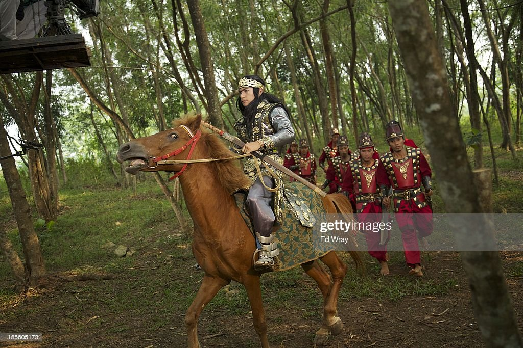 An actor performing as the 'bad guy' character Irmantara, rides through the forest during the production of Ciung Wanara, one of the many Indonesian soap operas based on traditional Indonesian legends on October 21, 2013 in Jakarta, Indonesia. The stories often involving kings, dragons, evil ministers, witches, gods and heroes, which were traditionally performed as shadow puppet plays and by professional storytellers, have a huge audience who have embraced the complex stories, much as western audiences have taken to the fictional intrigue of Game of Thrones.