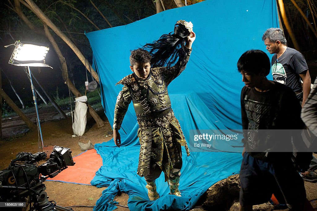 An actor performing as the character Hariang Banga takes off his wig after a scene during the production of Ciung Wanara, one of the many Indonesian soap operas based on traditional Indonesian legends on October 21, 2013 in Jakarta, Indonesia. The stories often involving kings, dragons, evil ministers, witches, gods and heroes, which were traditionally performed as shadow puppet plays and by professional storytellers, have a huge audience who have embraced the complex stories, much as western audiences have taken to the fictional intrigue of Game of Thrones.
