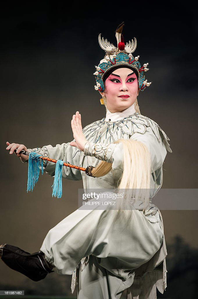 An actor performs during a Cantonese Opera in Hong Kong on February 12, 2013 as part of the Chinese New Year celebrations held in the city. Other than its southern dialect, Cantonese opera differs from mainland operatic traditions in its use of percussion instruments like gongs and cymbals. Actors wear elaborate costumes and make-up, and must be adept at elaborately choreographed martial arts as well as singing. AFP PHOTO / Philippe Lopez