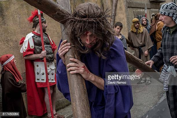 An actor portrays Jesus Christ as residents of Hiendelaencia gather before starting the reenactment of Christ's suffering on March 25 2016 in...