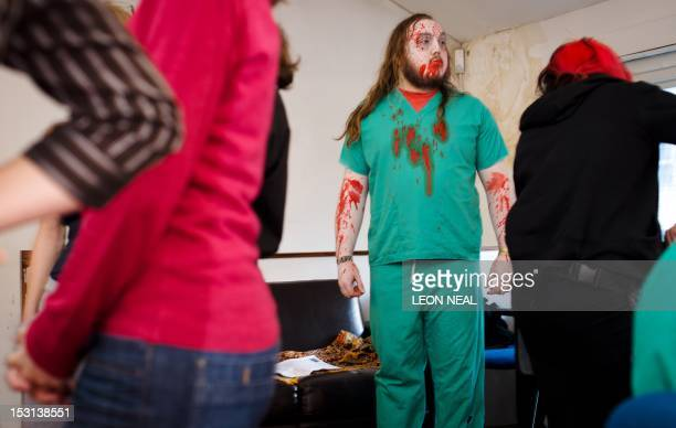 An actor stands in the makeup area ahead of the last of three nights of the zombie chase game '28 Hours Later' in central Manchester northern England...