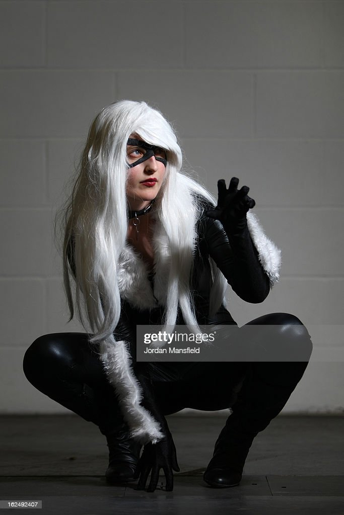 An actress dressed as Black Cat poses for a photo at the London Super Comic Convention at the ExCeL Centre on February 23, 2013 in London, England. Enthusiasts at the Comic Convention are encouraged to wear a costume of their favourite comic character and flock to the ExCeL to gather all the latest news in the world of comics, manga, anime, film, cosplay, games and cult fiction.