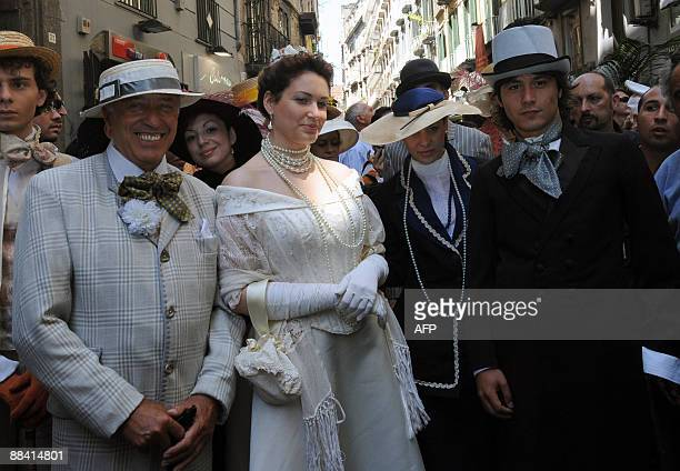 An actress dressed like Queen Margherita of Savoy arrives for a ceremony to celebrate the 120th anniversary of the pizza Margherita on June 11 2009...