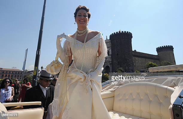 An actress dressed like Queen Margherita of Savoy arrives in a horse coach for a ceremony to celebrate the 120th anniversary of the pizza Margherita...
