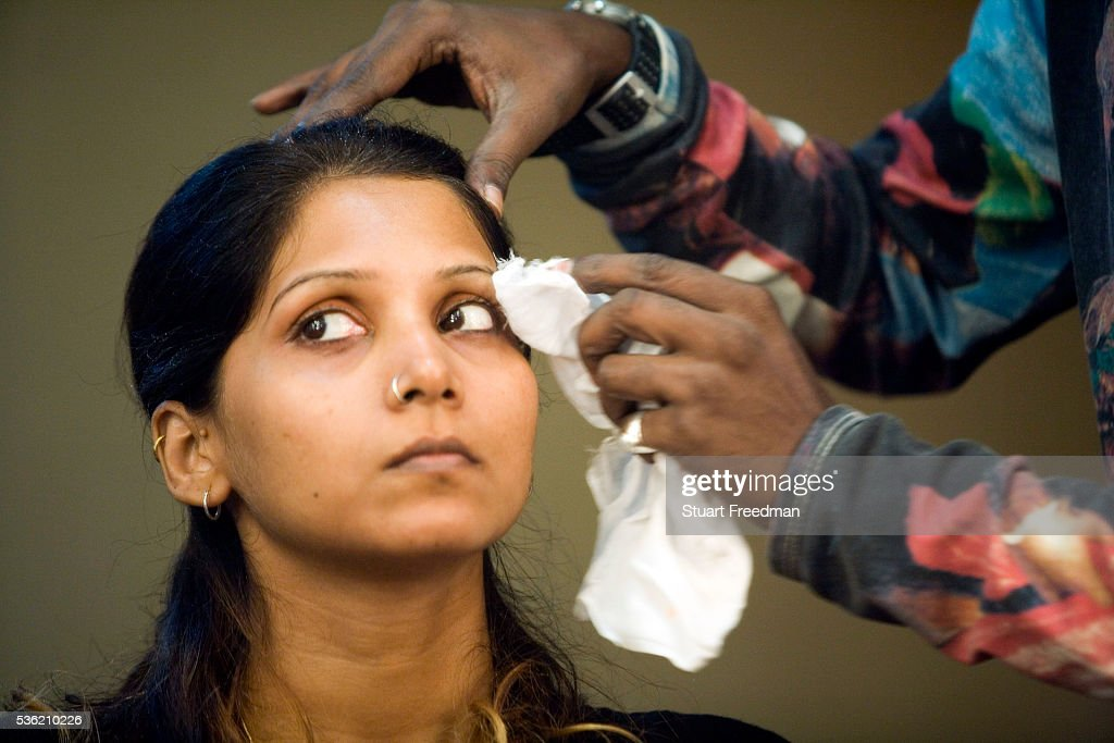 An actress is made up backstage during a rehearsal of the production of The Merchants of Bollywood in a studio in Mumbai India The Merchants of...