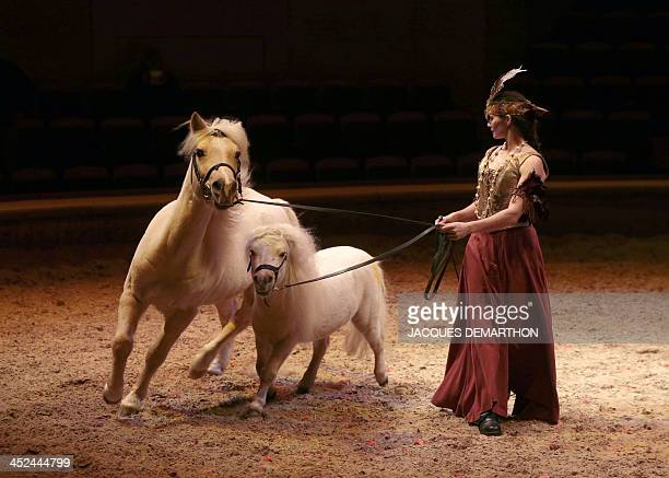 An actress performs during a dress rehearsal for the Christmas show of the Musee du Cheval at the Grandes Ecuries in Chantilly northern France on...