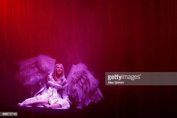 An actress performs on stage at the Aion stand during the 'gamescom' Europe's biggest trade fair for interactive games and entertainment on August 19...