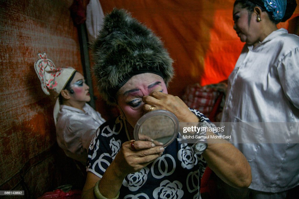 An actress puts on make-up at a makeshift theater before a performance during the Hungry Ghost Festival on August 5, 2016 in Kuala Lumpur, Malaysia. The Hungry Ghost Festival falls on the 15th day of the seventh lunar month. According to traditional Chinese belief, the seventh month in the lunar calendar is when restless spirits roam the earth. Many Chinese people make efforts to appease these transient ghosts, while feeding their own ancestors particularly on the 15th day, which is the Yu Lan or Hungry Ghost Festival.