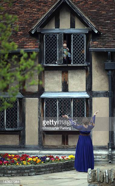 An actress spontaneously acts out the Romeo and Juliet balcony scene to a tourist and his young child looking out the window at William Shakespeare's...