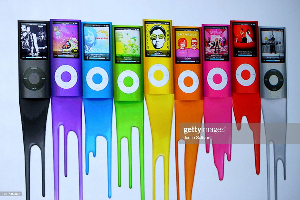 An ad shows colors of the new iPod Nano as Apple CEO Steve Jobs speaks during a special event September 9, 2008 in San Francisco, California. Jobs announced a new version of the popular iTunes software and a new iPod Nano.