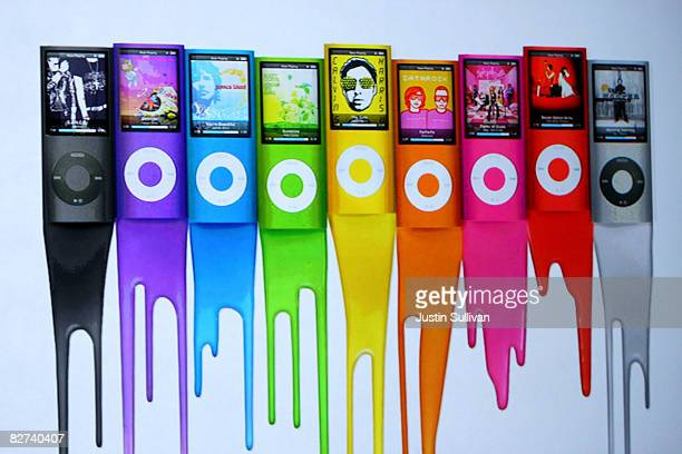An ad shows colors of the new iPod Nano as Apple CEO Steve Jobs speaks during a special event September 9 2008 in San Francisco California Jobs...