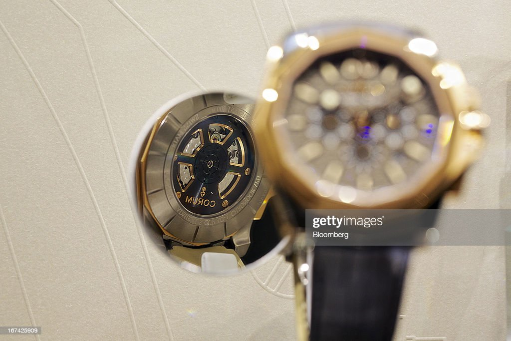 An Admiral's Cup AC One wristwatch, manufactured by Montres Corum, sits on display at the Baselworld watch fair in Basel, Switzerland, on Thursday, April 25, 2013. The annual fair attracts 2,000 companies from the watch, jewelry and gem industries to show their new wares to more than 100,000 visitors. Photographer: Gianluca Colla/Bloomberg via Getty Images