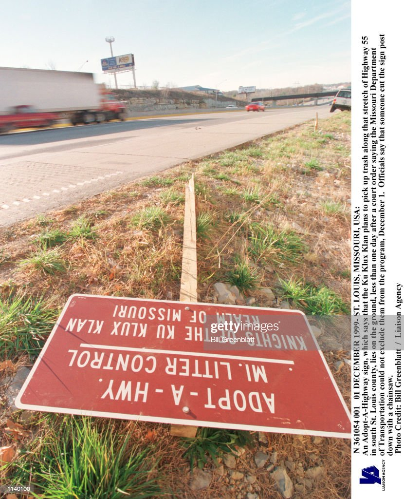 An Adopt-A-Highway sign, which says that the Ku Klux Klan plans to pick up trash along that stretch of Highway 55 in south St. Louis county, lies on the ground, less than one day after a court order saying the Missouri Department of Transportation could not exclude them from the program, December 1. Officials say that someone cut the sign post down with a chainsaw. bg/Bill Greenblatt UPI N 361054 001 01 DECEMBER 1999- ST.