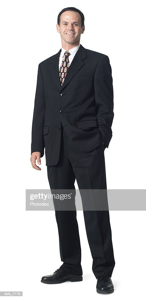 an adult caucasian business man in a suit puts a hand in his pocket and smiles : Stock Photo