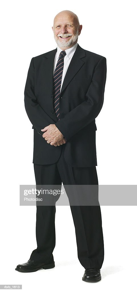 an adult caucasian business man with a beard in a suit and tie stands smiling