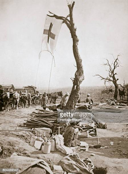 An advanced dressing station Somme campaign France World War I 1916 A Red Cross flag is affixed to a tree Artist Unknown
